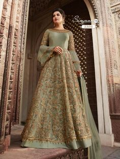 Pista green heavy embroidered anarkali suit online which is crafted from net fabric with exclusive embroidery and zari. This stunning designer anarkali suit comes with banglori bottom and net dupatta. Indian Gowns Dresses, Indian Fashion Dresses, Pakistani Bridal Dresses, Indian Designer Outfits, Designer Dresses, Fashion Outfits, Bridal Anarkali Suits, Pakistani Suits, Bridal Gowns