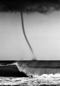 Barreling waves and a tornado at sea