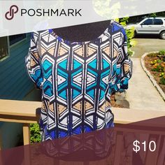 Multi Colored Printed Short Sleeve Shirt In amazing condition! Super comfortable and flowy! Only worn twice! Size Small. Tops Blouses