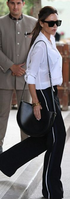 3b22ffe9a7 Chic style type street style victoria beckham in white button up and track  pants and victoria beckham half moon bag