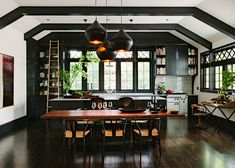 douglas fir flooring Kitchen Craftsman with Beat Lights black cabinets Black Ceiling Beams black kitchen