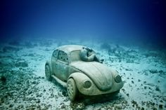 """""""The Anthropocene"""" is a life-size replica of a Volkswagen Beetle designed with a """"Lobster City"""" at its center—a system of tiered living spaces accessed through small holes near the car's wheels."""