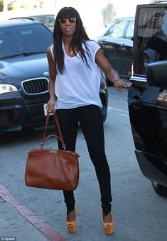 Balancing act: Kelly Rowland went shopping in Los Angeles, California, on Wednesday wearing six inch heels