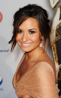 Demi Lovato will always be a role model to me. She has been through so much, but yet came out so strong. <3