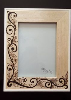 A lovely frame with a hand burned leaf design, looks striking with a picture in it. Size 5×7 photo. Overall size 8×10