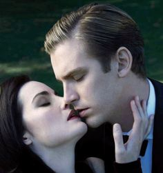 Lovers kiss..Michelle Dockery (Lady Mary Crawley) and beau Dan Stevens as Matthew from Downton Abbey in ES magazine 2011