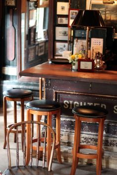 Features - foot rail, coat hooks, weathered bar paneling ... do not like the bar top though