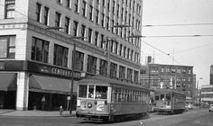 A Milwaukee Transport streetcar followed by a North Shore Line streetcar downtown.