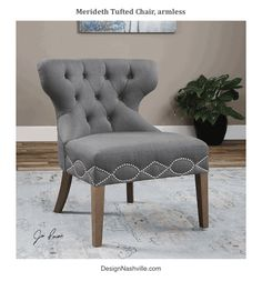 Meredith Tufted Chair, armless. nickel nail heads in a geometric pattern around the seat of the grey slipper chair. DesignNashville.com shipping to you.