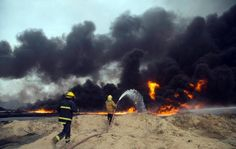 FILE - In this Aug. 31, 2016 file photo, Iraqi firefighters battle large fire at oil wells as they trying to prevent the flames from reaching the residential neighborhoods in Qayara, Iraq. A fire at one of Iraq's major oil fields could hinder military and humanitarian efforts as operations to recapture the Islamic State stronghold of Mosul get under way. Black smoke continues to billow into the air from the Qayara oil field, damaged by IS militants last month as they fled the town. There…