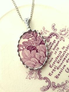 Dishfunctional Designs  The original contemporary jewelry handcrafted from broken vintage china...  Artist made broken china jewelry pendant