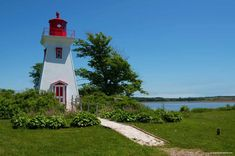 Popular PEI Road Trip Stops to the Beaches of West Point: In this post, we discuss Popular PEI road trip stops through the beaches of West Point and on through North Cape. A PEI road trip itinerary. Red Sand Beach, Beach Fun, Beautiful Ocean, Beautiful Places, Lighthouse Inn, Kailua Beach, Laying On The Beach, Canada Summer, Exotic Beaches