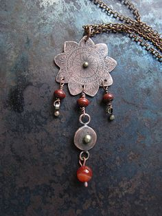 This statement pendant is a perfect birthday gift for girls and women who likes to dress in boho or casual style. Its also a great gift for a mother or a grandmother on Mothers Day, Christmas or any other holiday. The pendant is made of etched copper, brass and jasper agate beads. The