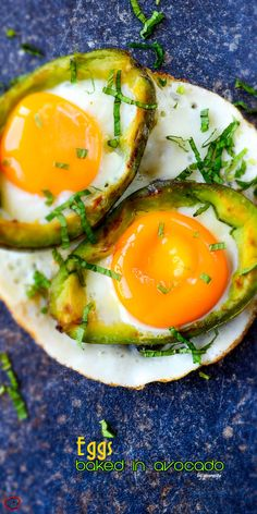 Eggs Baked in Avocado served on a naturally formed white plate. No oven needed! The yolks are perfectly soft unlike the oven baked versions. | giverecipe.com | #avocado #avocadorecipes #eggrecipes #healthyrecipes #breakfast #eggsbakedinoven