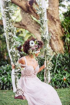 Totally romantic swing with ribbon & flowers by Passion Roots | Whimsical Enchanted Forest Wedding Dream On Soft Beds Of Green | Photograph by What a Day! Photography http://storyboardwedding.com/whimsical-enchanted-forest-wedding/