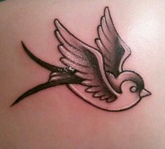 my lil' bird tattoo. Done with black gray and white.. Its open to interpretation I guess. I've had people say it looks like a sparrow or swallow.