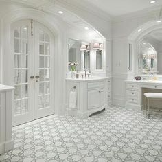 French doors to the bathroom. DecorPad - bathrooms - Restoration Hardware Newbury Bath Stool white built-in bathroom vanity marble top arched mirror arched French doors twin white bathroom cabinets marble countertops white gray mosaic tiles floor Houzz, White Bathroom Cabinets, White Cabinets, Stock Cabinets, Bathroom Doors, Bathroom Ideas, Bathroom Design Inspiration, Design Ideas, Classic Bathroom
