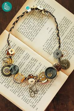 Necklace made with vintage buttons, charms and a clock by FraGiù. https://www.facebook.com/fragiuhandmade