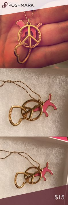 VS PINK long gold chain necklace NWOT New without tags Victoria's Secret pink long gold chain necklace with heart, peace symbol and pink dog goes great with any outfit ! PINK Victoria's Secret Jewelry Necklaces