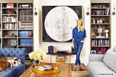 A prodigious, sparkling print from Russell Young's Cowboys and Indians Collection hangs prominently in the living room. Throughout, the home is composed of bright artwork grounded by rich,...