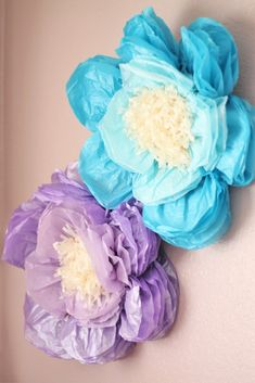 Love these DIY tissue paper flowers as wall decor in a big girl room - such a fun touch of whimsy!