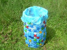 Bottle Caps Trash Can- but get rid of the plastic bag!