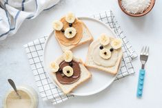 Breakfast toasts with nut butter and banana with cute funny animal face. Kids food by Arx0nt