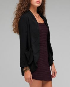 Need Supply Co. On a Whim Soft Jacket  Casual, tuxedo inspired jacket from Mink Pink. Features shawl collar with pleating detail around the neckline, chiffon front detail with chiffon bucket pockets, open front styling, and front to back cascading hemline.