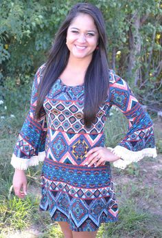 BLUE PATTERNED FRINGE DRESS  44.00 This dress has the PERFECT fit! It looks cute on everyone! With the fringe detailing on the sleeves, it makes this dress a must have for the fall weather!