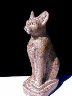 Vintage Hand Carved Sculpted Cat Goddess Bastet Statue  Carved from single piece of solid Rosa Kali Egyptian Granite stone  Gorgeous with exquisite attention paid to the tiniest details  The symmetry is stunning  Hand carved hieroglyphics adorn the base all the way around  Height 16 cm Base Width approx 5.5 cm