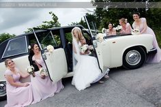 I love making 'formal groups' feel informal. This image shows off the amazing wedding car to fab effect & the seated composition feels very relaxed.
