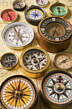 collection of old compasses...I wonder how compass parts could be incorporated into jewelry...ie steampunk?