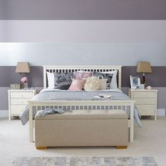 Bedroom with bold horizontal stripes  Create impact by jazzing up the wall behind the bed with horizontal bands of colour. Choose a toning palette and mix in a metallic paint for a show-stopping look. Start by painting the wall in a flat, subtle colour, then divide the wall up into equal bands.