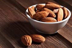 Nuts, like avocados, are loaded with heart-healthy fats. But healthy doesn't always mean lean. A couple of beers and a few handfuls of nuts and you've racked up some serious calories—and diet damage. Health Benefits Of Almonds, Almond Benefits, Almonds Nutrition, High Protein Recipes, Protein Foods, Vegan Foods, Protein Bars, Fit Foods, Healthy Fats