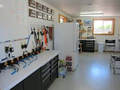 Kennel office....love the charging station for training collars and the giant white board!
