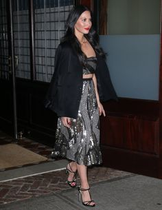 Olivia Munn stylish in a crop top and long skirt with t-strap high heels tooling around NYC