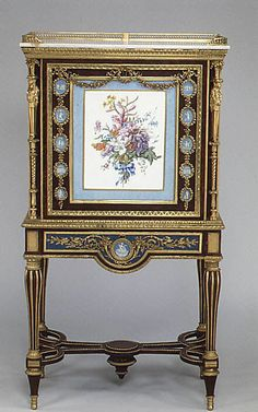 "Drop-front secretary on stand (Secrétaire à abattant or secrétaire en cabinet), c. 1787; Adam Weisweiler; France.  large soft-paste Sèvres porcelain plaque; 15 jasper medallion ""cameos"" made by Josiah Wedgewood & Sons. Oak veneered with burl thuya, amaranth, mahogany, satinwood, holly, and ebonized holly, painted metal, gilt-bronze mounts, marble top, gilt bronze mounts."