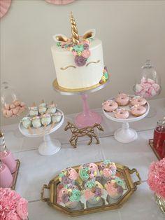 Unicorn cake unicorn cake pops unicorn donuts unicorn cupcakes gold and pink sweettable