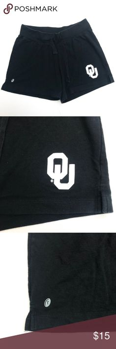 """Russell Athletic Women Black Medium OU Logo Shorts - Russell - Women's Size: Medium  - Black Casual Shorts  - OU Logo in White  - Drawstrings  - Stretchy Waistband  - Great Preowned Condition   Measures Approximately: Length: 13"""" Waist: 15"""" Rise: 10"""" Inseam: 4.5"""" Leg Opening: 12""""  A-357 Russell Athletic Shorts"""