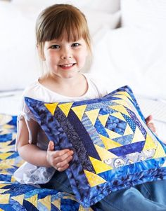 Patchwork Pillow Pair - Piece squares and rectangles into classic Pineapple and Log Cabin blocks to easily create a stunning sun-and-sky color duo.