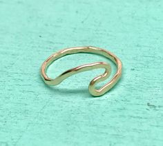 A personal favorite from my Etsy shop https://www.etsy.com/listing/548088630/wave-ring-14k-gf-or-sterling-silver