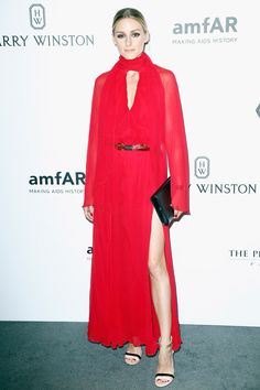 3 July 2016 - Olivia Palermo chose a high-necked red dress for the occasion.   - HarpersBAZAAR.co.uk