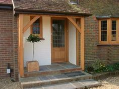 Oak door windows and porch replacement sash bay window in muswell hill Front Door Steps, Front Door Porch, Porch Doors, Front Porch Design, Side Porch, Entrance Doors, Windows And Doors, Porch Designs, Front Porches