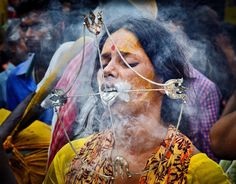 Devotion  The painful religious ritual by a devotee during VEL VEL festival , India