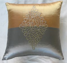 silver and gold pillow
