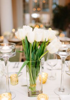 Crisp ivory tulips are a lovely option for a floral centrepiece.