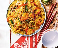 This noodle dish gets its signature bright yellow colour from golden turmeric. We've substituted leaner pork tenderloin for the traditional barbecued pork (but if you can find the real thing, it's definitely worth using). This recipe yields a lot, so be s
