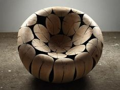 Pine and Chestnut Chair by Lee Jae-Hyo. A biomorphic chair made of sculpted wood logs. mocoloco via DesignDaysDubai.