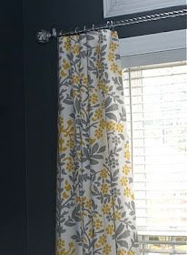 Love the yellow with the deep blue wall. Tablecloths for Curtains
