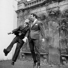 Jimmy Greaves and Norman Wisdom clown around during a visit to Pinewood Studios by the 1966 World Cup Squad. Norman Wisdom, Jimmy Greaves, 1966 World Cup, Class Games, Tottenham Hotspur Fc, Clowning Around, Civil Rights Movement, North London, Film Stills